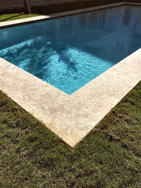 Caribbean Shell Stone Brushed 24x24 as Pool Coping